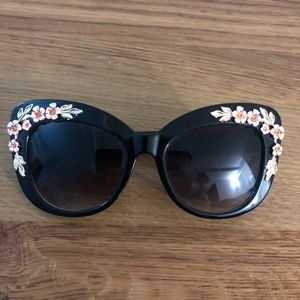 Black sunglasses with rose embellishment